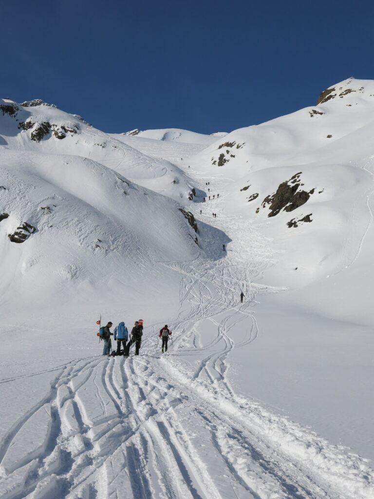 People skiing in spring snowpack in the Ortler, illustrating human factors